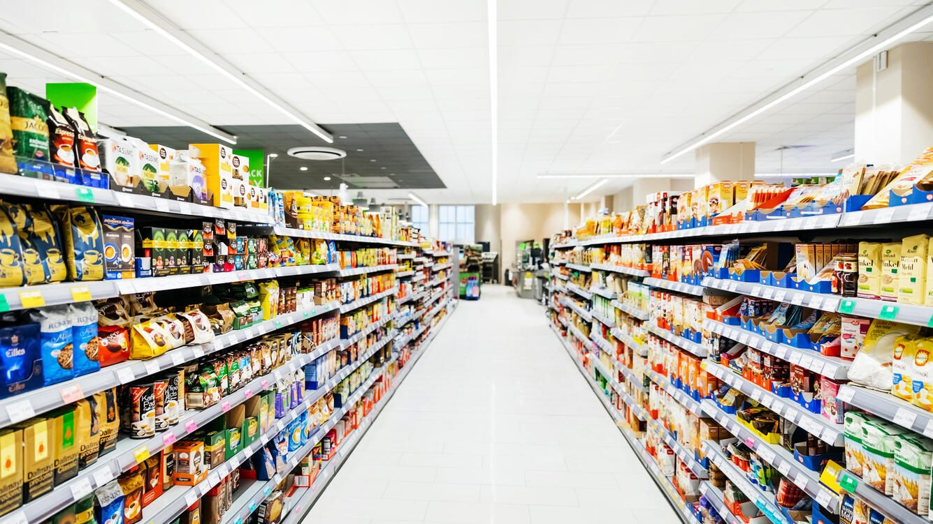 An empty supermarket filled with stock and merchandise.