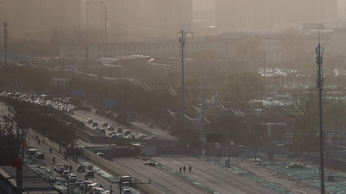BEIJING, CHINA - MARCH 29: Cars drive on the road which is enveloped by heavy smog on March 29, 2019 in Beijing, China. (Photo by VCG/VCG via Getty Images)
