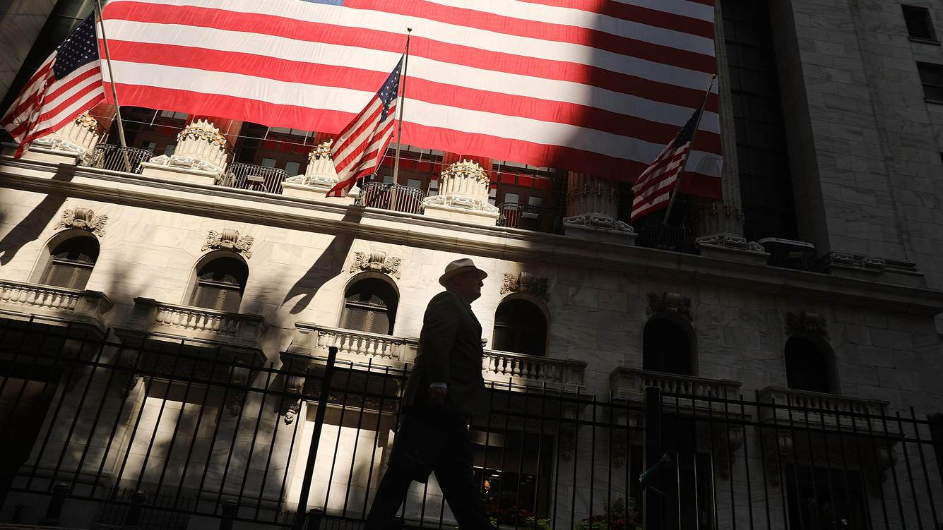 NEW YORK, NY - JULY 12:  A man walks by the New York Stock Exchange (NYSE) on July 12, 2018 in New York City. As fears of a trade war eased with China, the Dow Jones Industrial Average rose 140 points in morning trading.  (Photo by Spencer Platt/Getty Images)