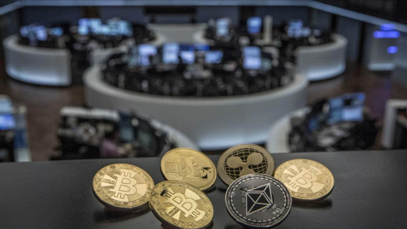 GERMANY, FRANKFURT - SEPTEMBER 28: Symbol photo on the topics digital curreny, cryptocurrency, currency speculation, stock market, etc. The picture shows Bitcoin, Ripple, Litecoin and Ethereum coins (physically) on the balcony of the trading hall of the German Stock Exchange in Frankfurt.  (Photo by Ulrich Baumgarten via Getty Images)