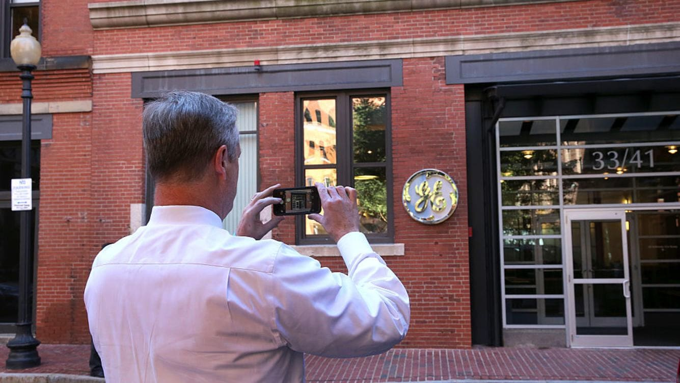 BOSTON, MA - AUGUST 22: Gov. CharlIe Baker takes a photo of the GE entrance. General Electric has opened its new headquarters in Fort Point on Farnsworth Street in Boston, Aug. 22, 2016. (Photo by David L. Ryan/The Boston Globe via Getty Images)