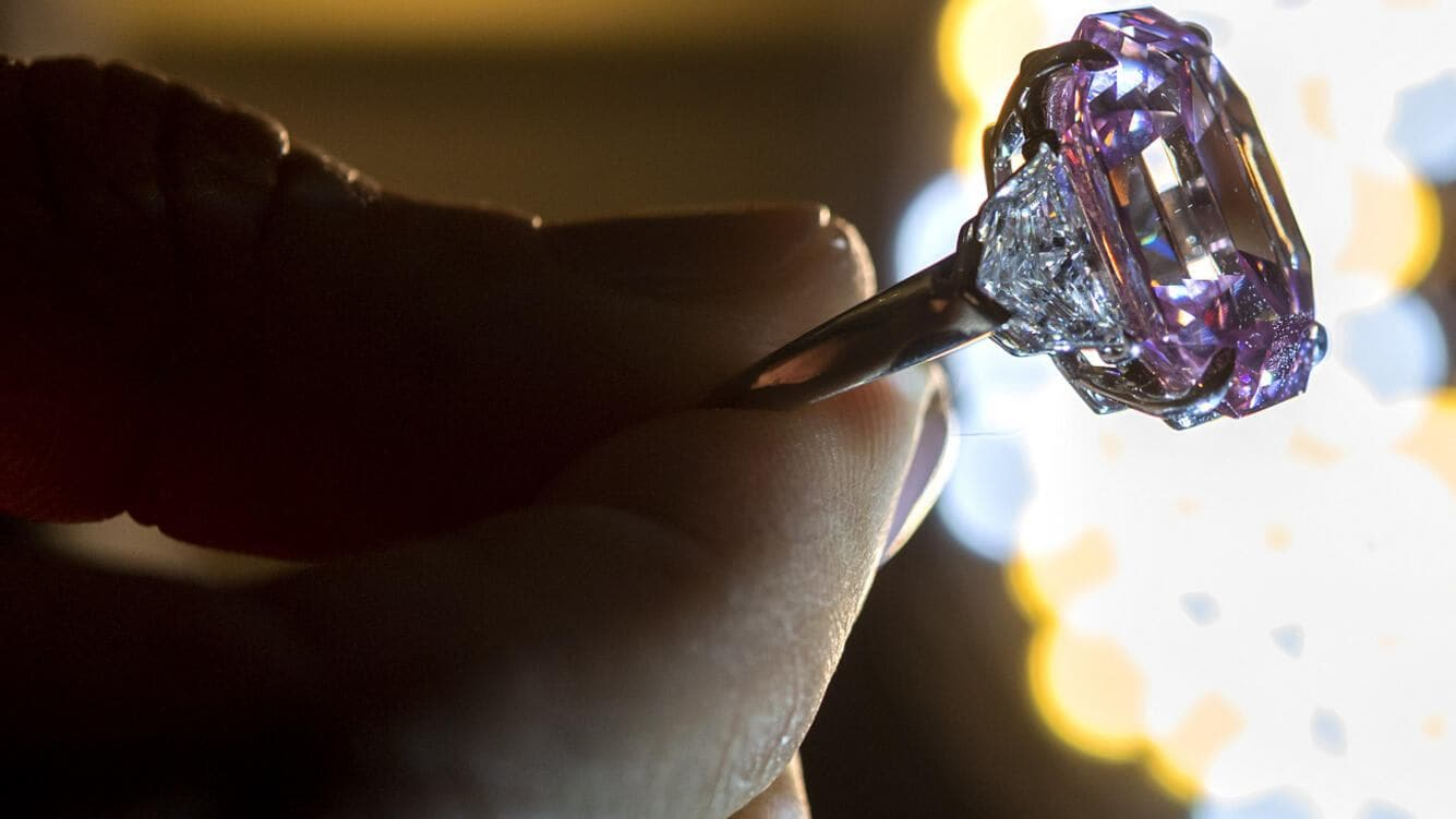 A Christie's employee displays a 18.96 carat Fancy Vivid Pink Diamond during a preview at the ChristieÕs, in Geneva, Switzerland, Thursday, November 8, 2018. It is estimated to sell between 30 - 50 millions US dollars. The auction will take place in Geneva, on November 13, 2018. (KEYSTONE/Martial Trezzini)