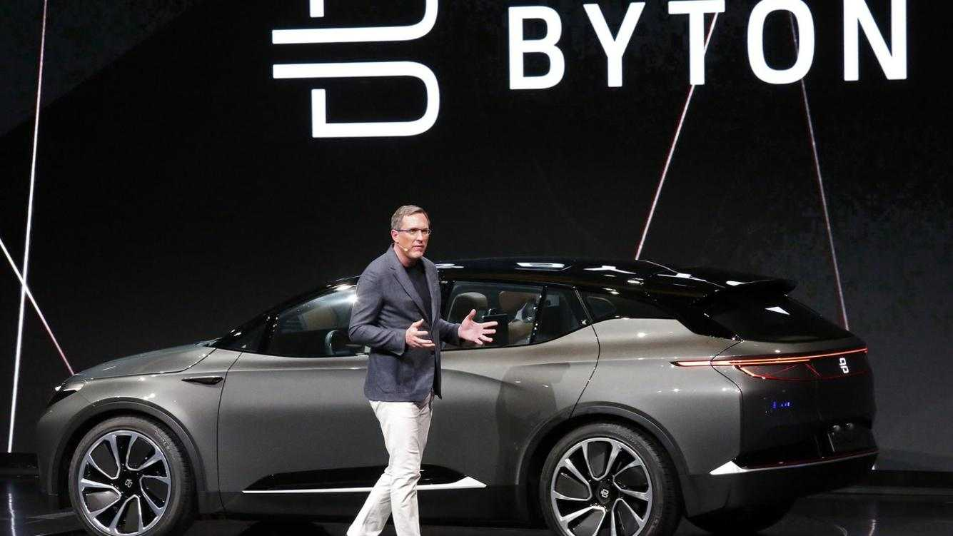 epa06423771 President and Co-Founder Dr. Daniel Kirchert talk about the new Byton electric car at the 2018 International Consumer Electronics Show in Las Vegas, Nevada, USA, 07 January 2018. The annual CES which takes place from 9-12 January is a place where industry manufacturers, advertisers and tech-minded consumers converge to get a taste of new innovations coming to the market each year.  EPA/LARRY W. SMITH