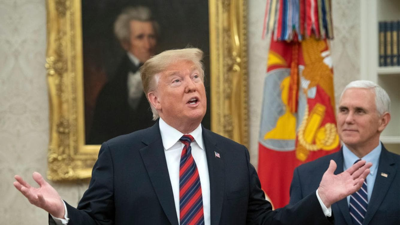 WASHINGTON, DC - JANUARY 19: U.S. President Donald Trump makes remarks as he hosts a naturalization ceremony in the Oval Office of the White House in Washington, DC on January 19, 2019.  Looking on at right is Vice President Mike Pence. (Photo by Ron Sachs-Pool/Getty Images)