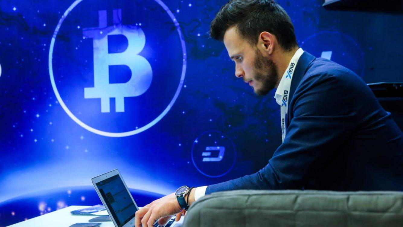 ST PETERSBURG, RUSSIA  NOVEMBER 7, 2018: A man using a laptop during Blockchain Life 2018, a forum on blockchain, cryptocurrency, and mining. Peter Kovalev/TASS (Photo by Peter Kovalev\TASS via Getty Images)