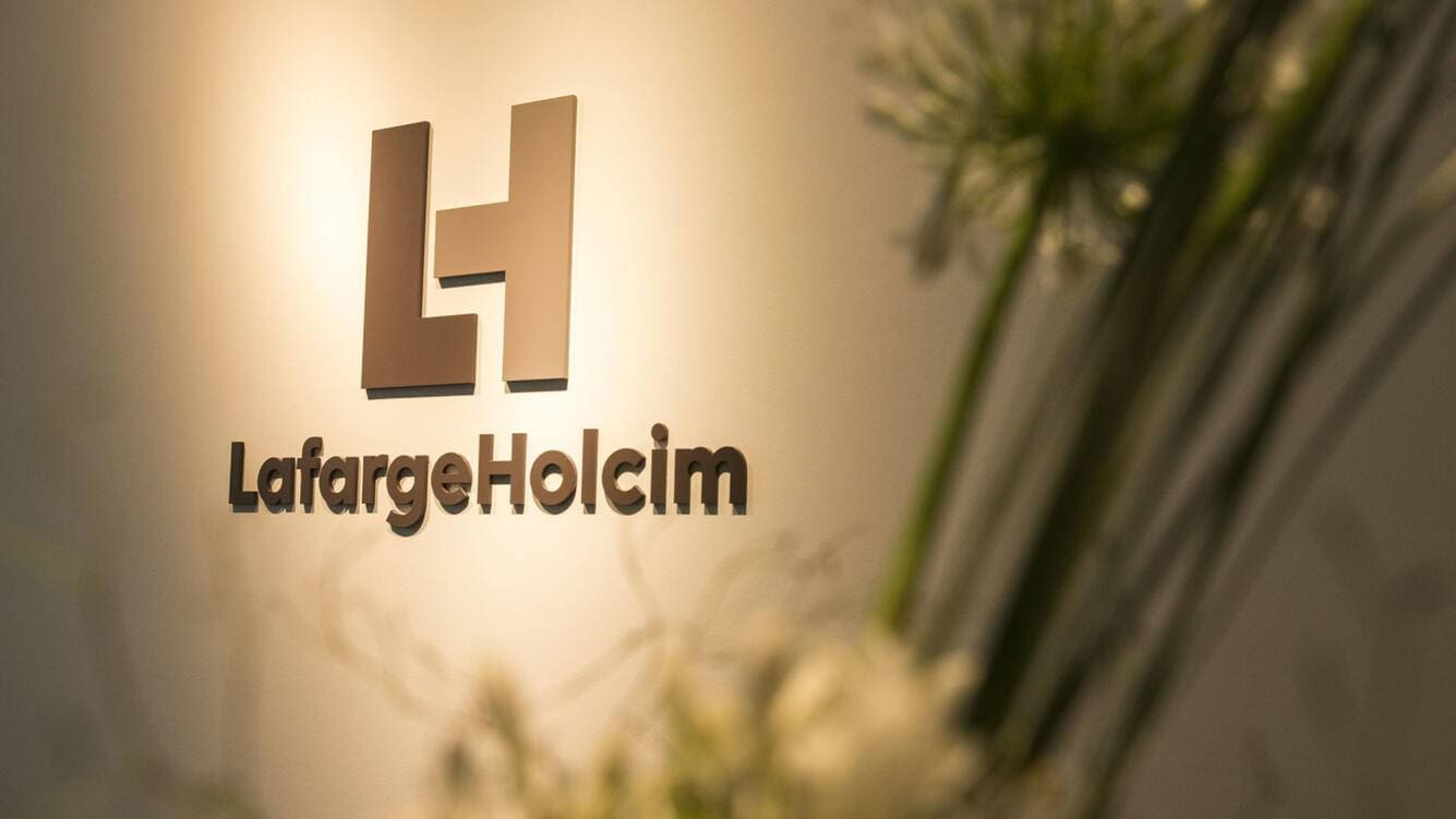 The new logo of LafargeHolcim at the welcome desk of the head quarters in Zurich, Switzerland, on Wednesday, 15 July 2015. LafargeHolcim today officially launched the new Group around the world and announced key elements of its ambitions for the future. (KEYSTONE/Patrick B. Kraemer)