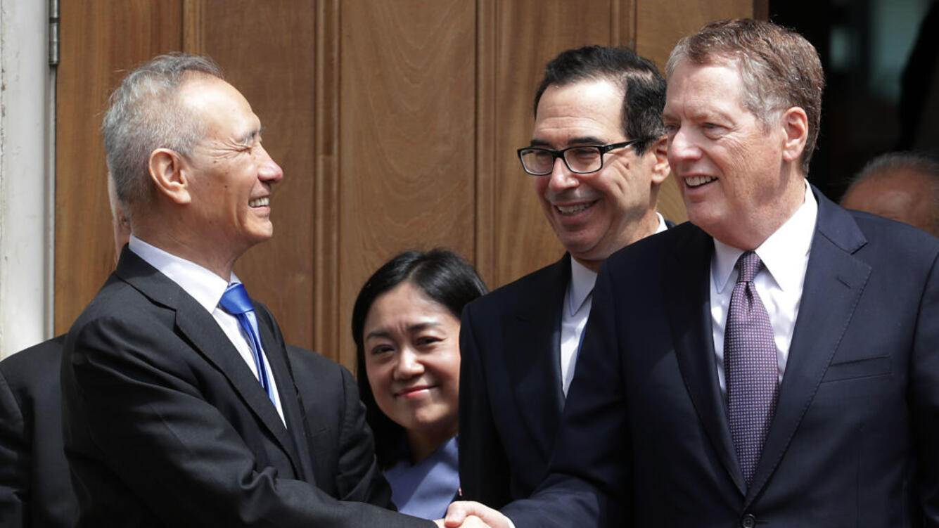 WASHINGTON, DC - MAY 10: Chinese Vice Premier Liu He (L) says goodby to U.S. Treasury Secretary Steven Mnuchin (C) and U.S. Trade Representative Robert Lighthizer as they break from meetings at the USTR offices May 10, 2019 in Washington, DC. The leaders from China and the U.S. met Friday, hours after President Donald Trump imposed tariffs on $200 billion on Chinese goods (Photo by Chip Somodevilla/Getty Images)