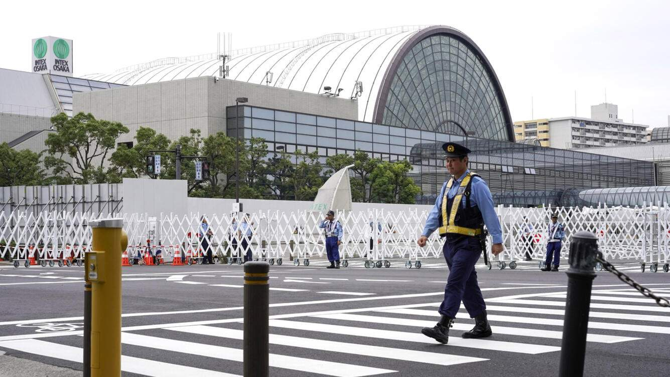 A police officer walks in front of the venue of the G20 summit in Osaka, western Japan, Wednesday, June 26, 2019. The two-day summit starts Friday. (AP Photo/Eugene Hoshiko)