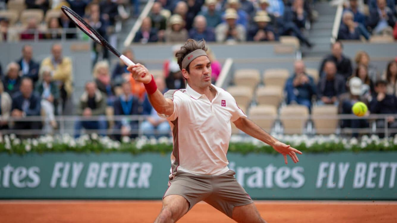 PARIS, FRANCE June 07.  Roger Federer of Switzerland in action against Rafael Nadal of Spain on Court Philippe-Chatrier during the Men's Singles Semifinals match at the 2019 French Open Tennis Tournament at Roland Garros on June 7th 2019 in Paris, France. (Photo by Tim Clayton/Corbis via Getty Images)
