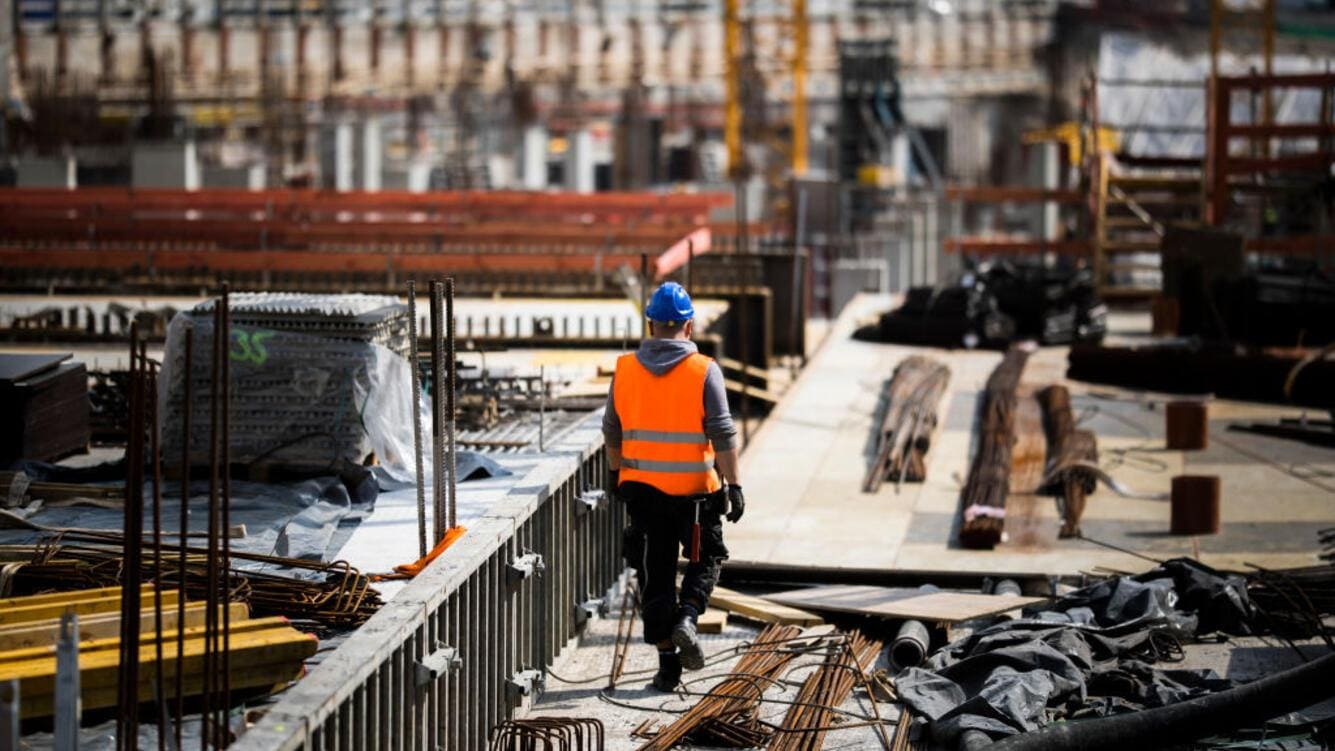 BERLIN, GERMANY - APRIL 24: A worker is pictured on a construction site on April 24, 2019 in Berlin, Germany. (Photo by Florian Gaertner/Photothek via Getty Images)