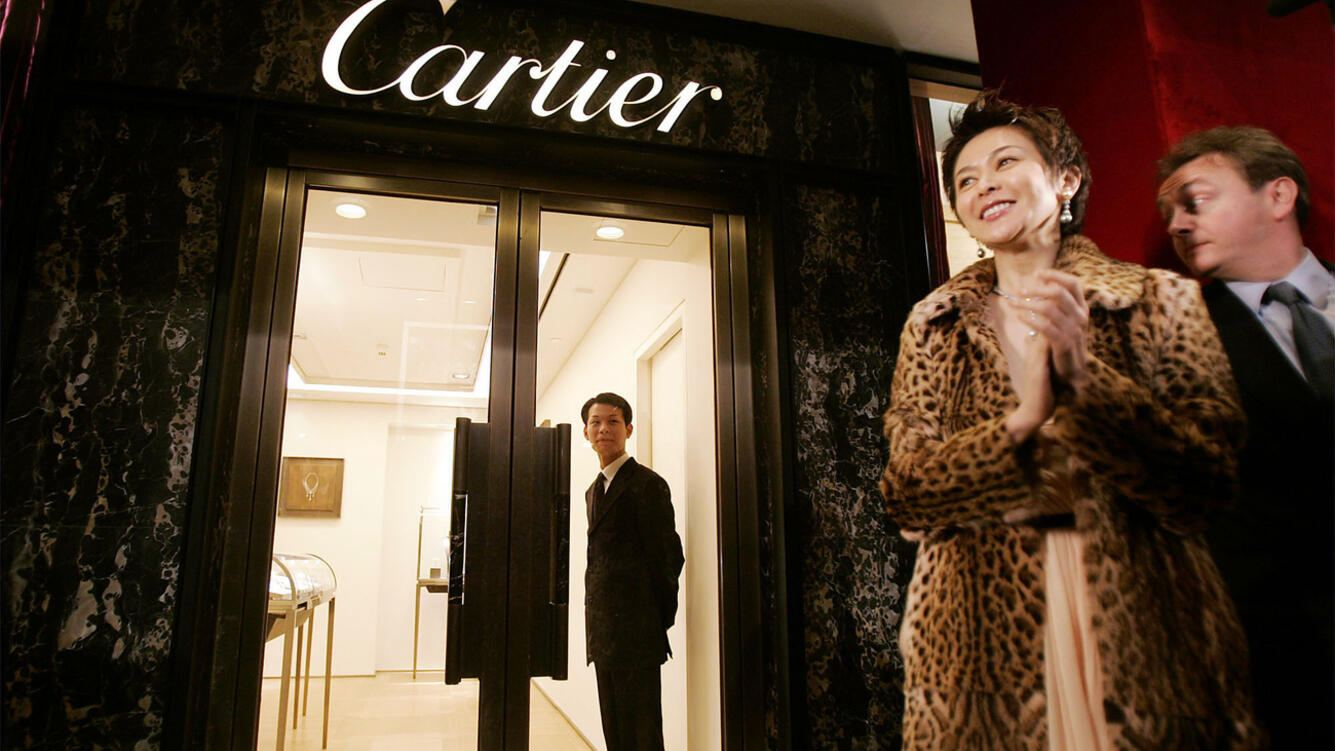 Hong Kong movie star Rosamund Kwan, second from right,  applauds during an opening ceremony of new boutique Saturday Dec. 18, 2004 in Shanghai, China. French jewelry manufacture Cartier opened a flagship boutique Saturday on Shanghai's famed river front Bund, joining a wave of foreign designers targeting China's new rich. (KEYSTONE/AP Photo/Eugene Hoshiko)