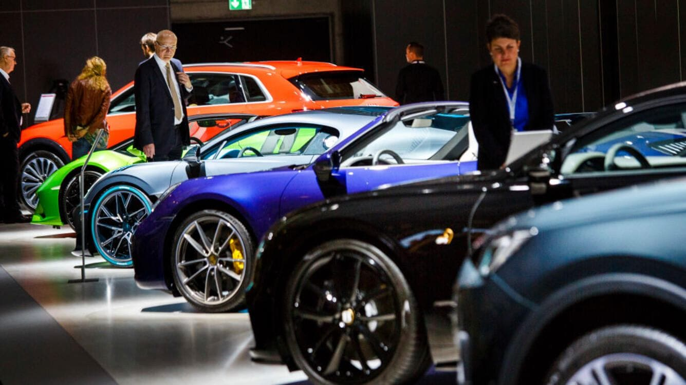 BERLIN, GERMANY - MAY 14: Shareholders look at cars from different companies of Volkswagen AG during the company's annual shareholders' meeting on May 14, 2019 in Berlin, Germany. Volkswagen is still grappling with the consequences of its diesel emissions scandal, which the company said has cost it EUR 30 billion so far. Proxy advisory groups are urging shareholders to vote against the continuation of the current Volkswagen governing board. (Photo by Carsten Koall/Getty Images)