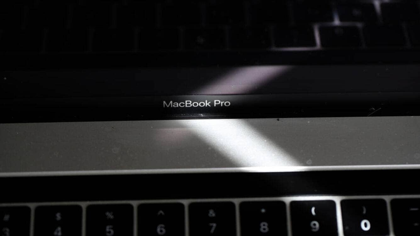 SAN ANSELMO, CALIFORNIA - JUNE 27: In this photo illustration, the MacBook Pro logo is displayed on an Apple MacBook Pro laptop on June 27, 2019 in San Anselmo, California. Apple announced a recall of an estimated 432,000 15-inch MacBook Pro laptops due to concerns of overheating batteries that could catch fire. The recall is for 15-inch MacBook Pro laptops sold between September 2015 and February 2017. (Photo Illustration by Justin Sullivan/Getty Images)