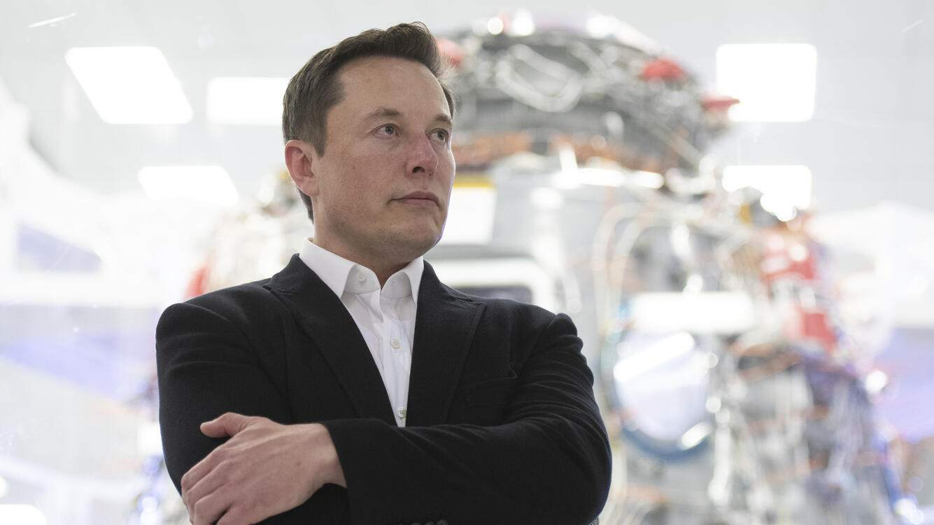 SpaceX Chief Engineer Elon Musk speaks in front of Crew Dragon cleanroom at SpaceX Headquarters in Hawthorne, California on October 10, 2019. (Photo by Yichuan Cao/NurPhoto via Getty Images)