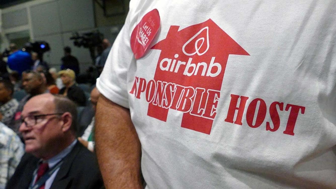 An Airbnb supporter waits his turn to speak at a City of Miami commission meeting discussing Airbnb on Thursday, March 23, 2017. Miami Beach is considering new measures to fight illegal short-term rentals on the island. (C.M. Guerrero/Miami Herald/TNS) Photo via Newscom (KEYSTONE/NEWSCOM/C.M. GUERRERO)