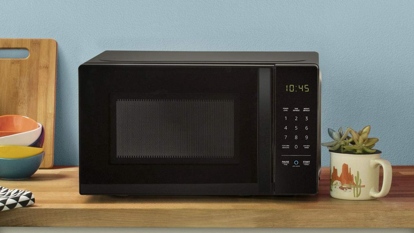This undated photo provided by Amazon shows a new microwave oven that connects with Amazon's Echo devices. Amazon wants the most basic of tasks to be controlled by voice, from microwaving potatoes to switching up the music in the car. The company unveiled several gadgets on Thursday, Sept. 20, 2018, furthering Amazon's goal of placing its Alexa voice assistant everywhere its customers are. (Amazon via AP)