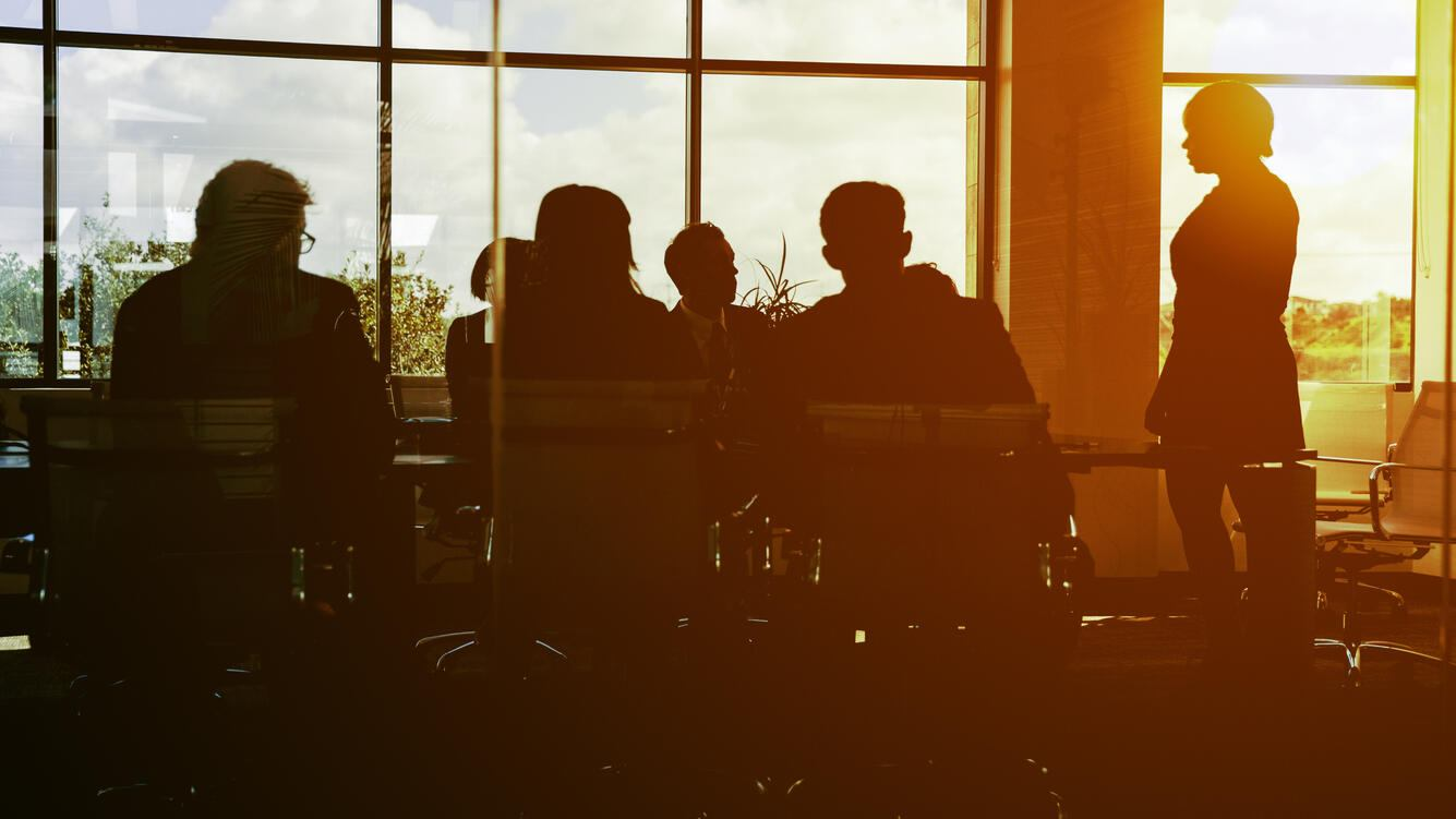 A team works as the sun sets over their office