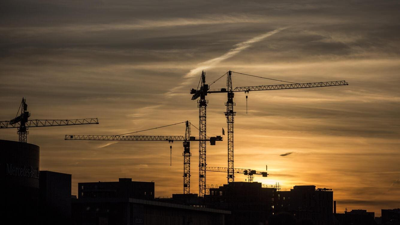 BERLIN, GERMANY - APRIL 06: Construction cranes in front of an evening horizon and sunset in Berlin on April 06, 2018 in Berlin, Germany. (Photo by Florian Gaertner/Photothek via Getty Images)