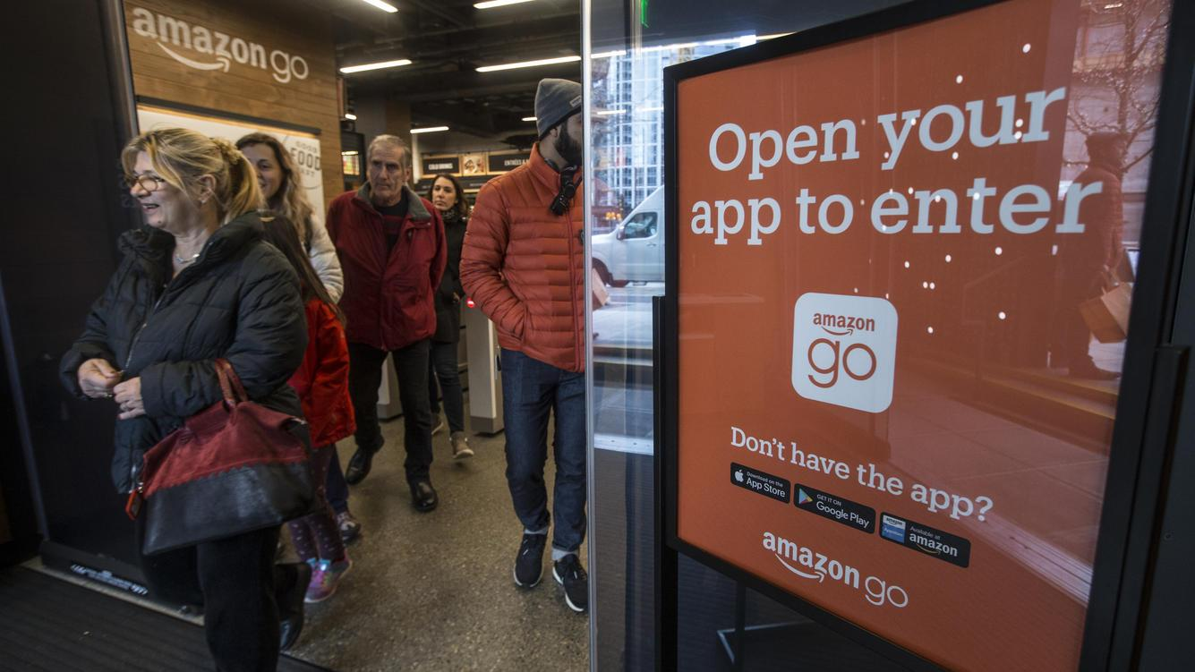 SEATTLE, WA - JANUARY 22: Shoppers leave the Amazon Go store after checking out on January 22, 2018 in Seattle, Washington. After more than a year in beta, the store is open to the public. (Photo by Stephen Brashear/Getty Images)