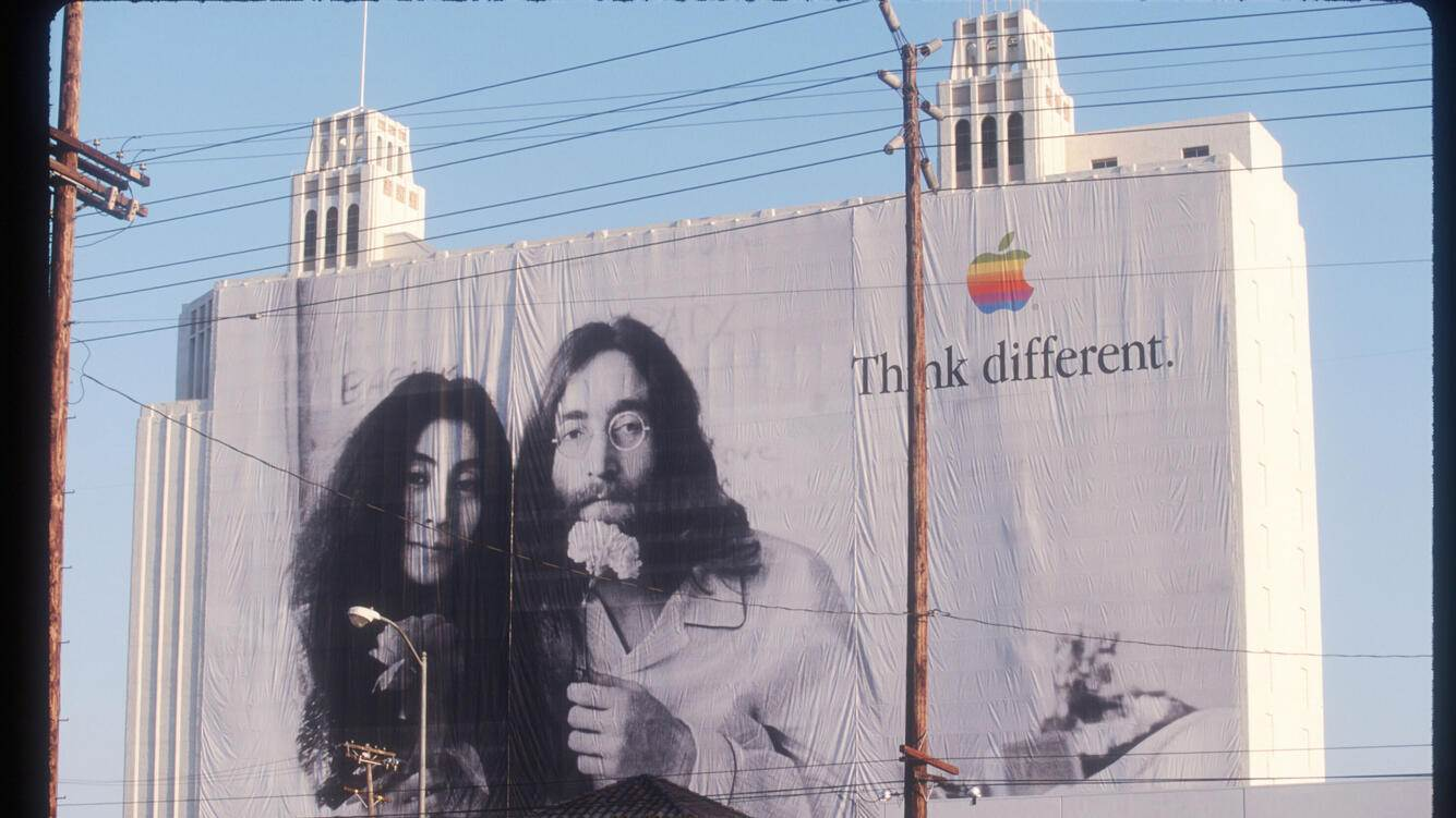 """336169 02: A billboard depicting John Lennon and Yoko Ono promotes Apple Computers August 1, 1998 in Los Angeles, CA. Numerous famous and historical figures are featured in a series of Apple Computer's """"Think Different"""" advertisements including Picasso, Muhammad Ali, Ted Turner and the Dalai Lama. (Photo by Gilles Mingasson/Liaison)"""