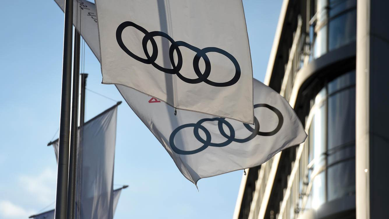 INGOLSTADT, GERMANY - MARCH 14: Flags with the logo of the German car manufacturer Audi blow in the wind in front of the Audi headquarters on March 14, 2018 in Ingolstadt, Germany. U.S. President Donald Trump has threatened to impose tariffs on German-made cars should the European Union impose counter tariffs on U.S. products following the announcement by Trump to hit imported steel and aluminum with tariffs. (Photo by Andreas Gebert/Getty Images)
