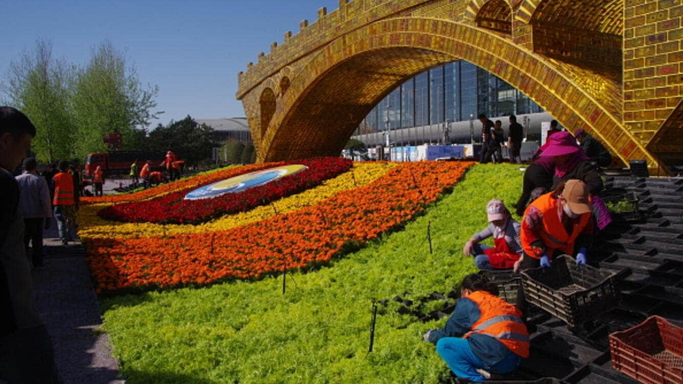 Workers set up flower parterres at the 'Golden Bridge on Silk Road' for the upcoming 2nd Belt and Road Forum for International Cooperation on April 14, 2019 in Beijing, China. The 2nd Belt and Road Forum for International Cooperation will be held in Beijing at the end of April. (Photo by Yang Xiancan/Qianlong.com/VCG via Getty Images)