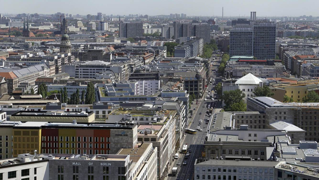 In this Tuesday, May 8, 2018 photo the Potsdamer Platz (Potsdam Square) is photographed towards east in Berlin, Germany. (AP Photo/Michael Sohn)