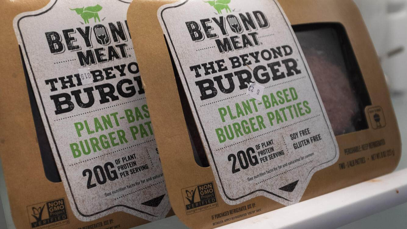 """NEW YORK, NY - JUNE 13: In this photo illustration, packages of Beyond Meat """"The Beyond Burger"""" sit in a refrigerator, June 13, 2019 in the Brooklyn borough of New York City. Since going public in early May, Beyond Meat's stock has soared more than 450 percent and its market value is over $8 billion. Beyond Meat is a Los Angeles-based producer of plant-based meat substitutes, including vegan versions of burgers and sausages. (Photo Illustration by Drew Angerer/Getty Images)"""