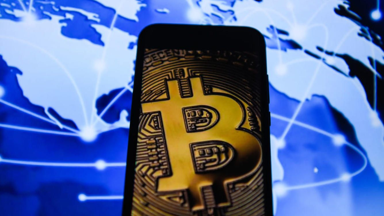 Bitcoin is seen on an android mobile phone.