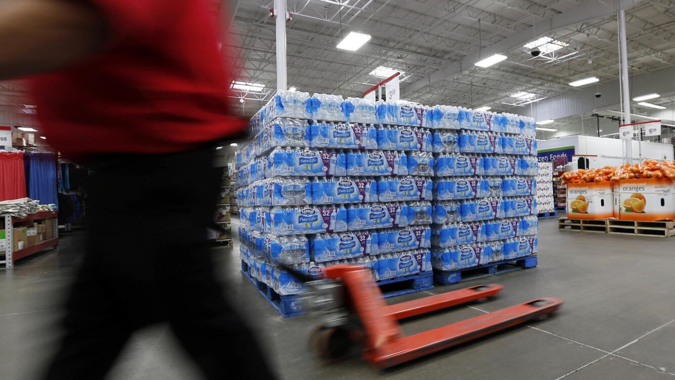 A customer walks past this Nestle Pure Life water display at this Jackson, Miss., Sam's Club, Tuesday, March 5, 2013. The public's desire for bottled water continues to climb as soft drinks wane and consumers benefit from the growing choice of waters. (AP Photo/Rogelio V. Solis)