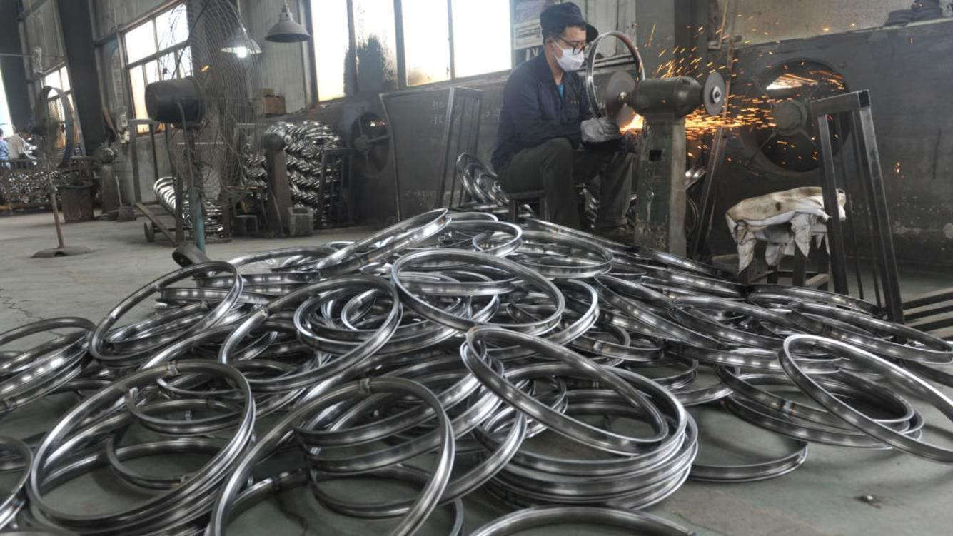 A worker labors in a factory of steel wheel rims in Hangzhou in east China's Zhejiang province Monday, June 04, 2018. The company said its export to the U.S. is one quarter lower due to the ongoing trade disputes.PHOTOGRAPH BY Feature China / Barcroft Images (Photo credit should read Feature China / Barcroft Images / Barcroft Media via Getty Images)