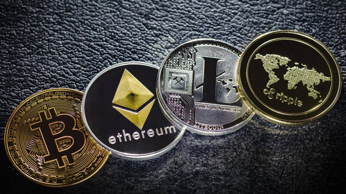 Berlin, Germany - April 10: In this photo illustration coins of the crypto currencies bitcoin, ethereum litecoin and ripple stands on a hard disk on April 10, 2018 in Berlin, Germany. (Photo Illustration by Thomas Trutschel/Photothek via Getty Images)