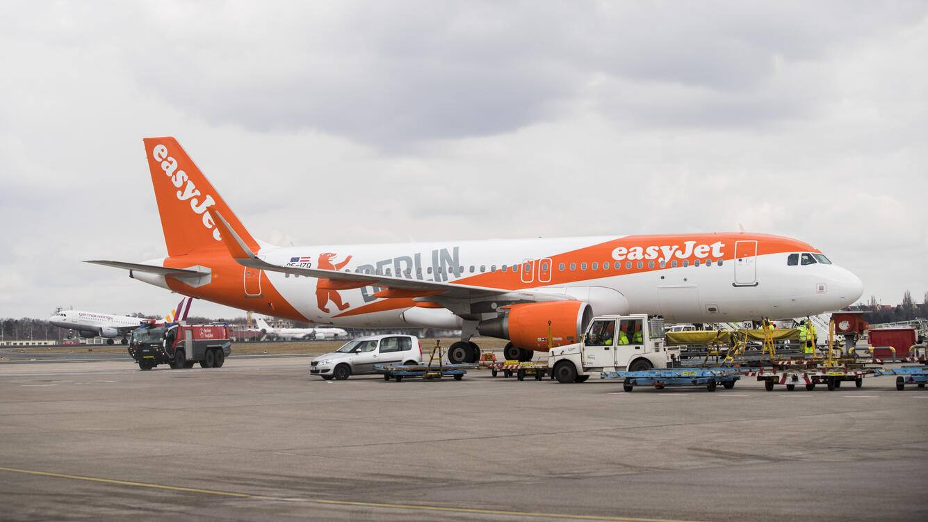 An easyJet plane carrying a Berlin design arrives at Tegel airport in Berlin, Germany on March 27, 2018. The airline presented today the summer flight plan. Starting from this summer season the airline will become the biggest actor in Berlin with over 16 millions seats offer per year. (Photo by Emmanuele Contini/NurPhoto via Getty Images)
