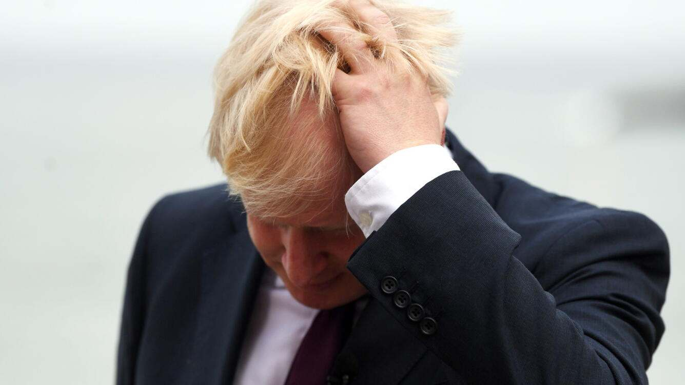 epa07823061 (FILE) - Britain's Prime Minister Boris Johnson reacts during a TV interview ahead of bilateral meetings as part of the G7 summit in Biarritz, France, 25 August 2019 (reissued 06 September 2019). According to media reports, the British House of Lords approved the new law against a no-deal Brexit on 06 September 2019. EPA/NEIL HALL