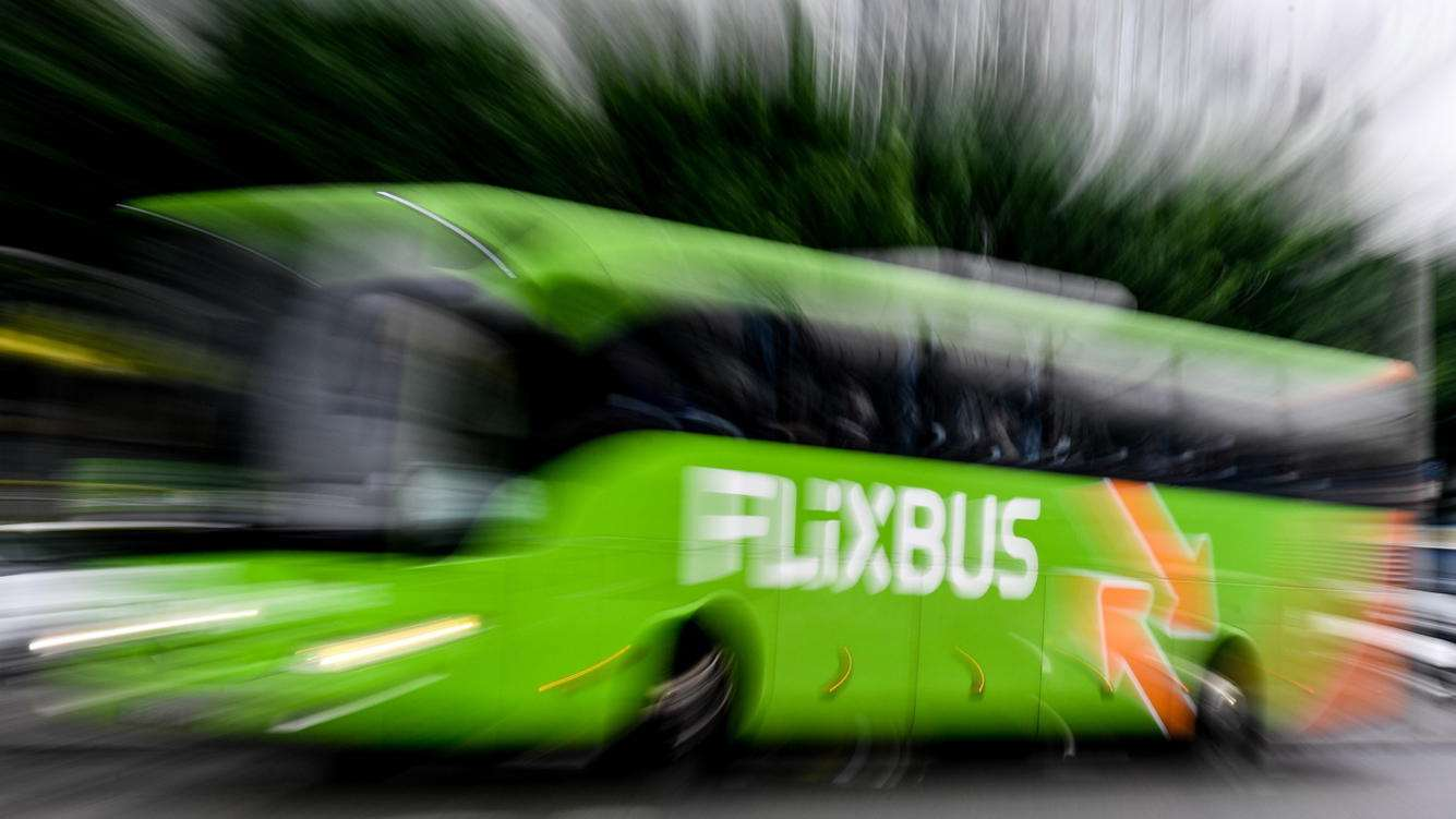 epa06741385 A picture taken with a zoom effect shows a Flixbus bus drives in Dresden, Germany, 16 May 2018. The German bus company is launching its data-driven bus service in the United States, choosing US west coast on starting of its operation.  EPA/FILIP SINGER