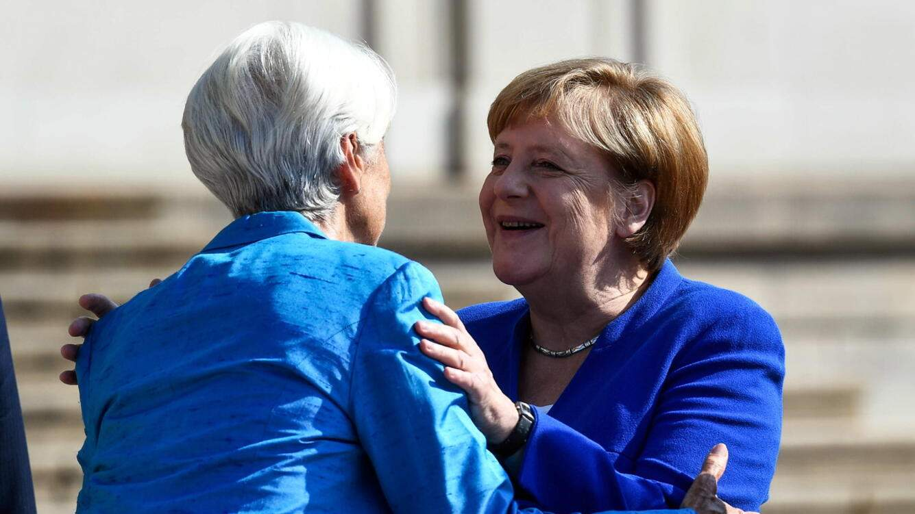 epa07806088 German Chancellor Angela Merkel (R) greets Managing Director of the International Monetary Fund (IMF) Christine Lagarde (L) before the ceremony of honorary doctorate by HHL Leipzig Graduate School of Management at the Opera Leipzig, Leipzig, Geremany, 31 August 2019. EPA/FILIP SINGER