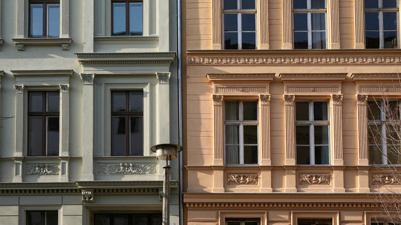 Facades of ornate residential buildings in the district of Prenzaluer Berg, Berlin, Germany