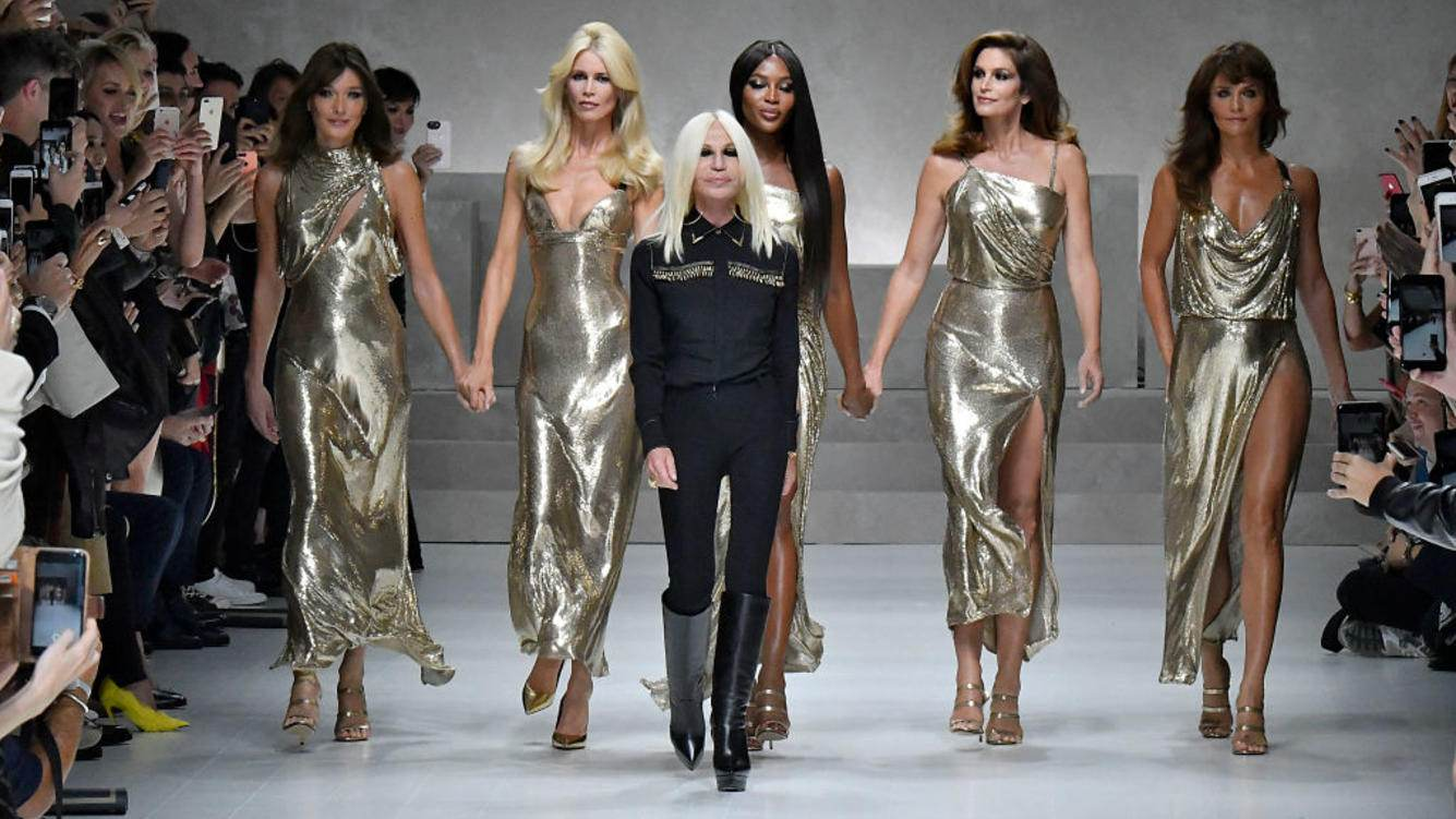 Carla Bruni, Claudia Schiffer, Donatella Versace, Naomi Campbell, Cindy Crawford and Helena Christensen walks the runway at the Versace Ready to Wear Spring/Summer 2018 fashion show during Milan Fashion Week Spring/Summer 2018 on September 22, 2017 in Milan, Italy. (Photo by Victor VIRGILE/Gamma-Rapho via Getty Images)