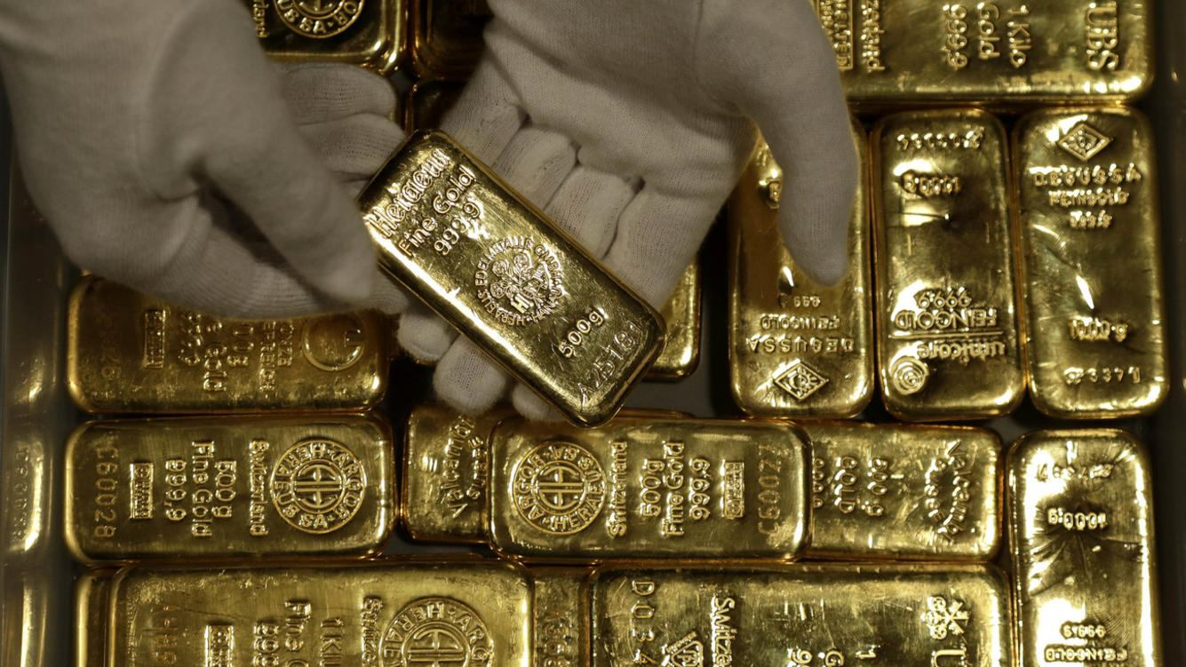 Employees of ProAurum gold house prepares 0.5 Kg gold bars of 999.9 purity in the safe deposit boxes room in Munich, Germany, Thursday, Dec. 13, 2018. (AP Photo/Matthias Schrader)
