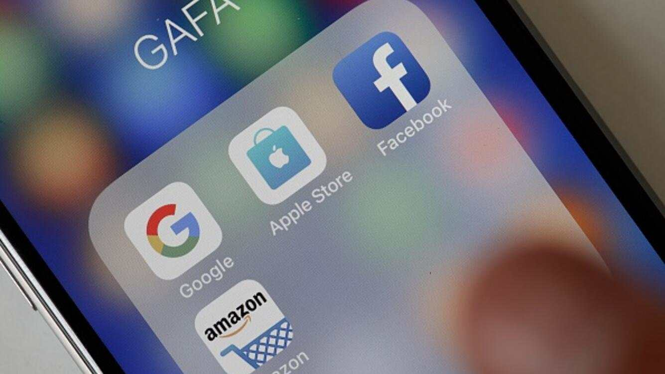In this photo illustration, logos of the Google, Apple, Facebook, and Amazon applications (GAFA) are displayed on the screen of an Apple iPhone on May 31, 2018 in Paris, France. The acronym GAFA refers to the four most powerful companies in the world of the internet: Google, Apple, Facebook and Amazon.
