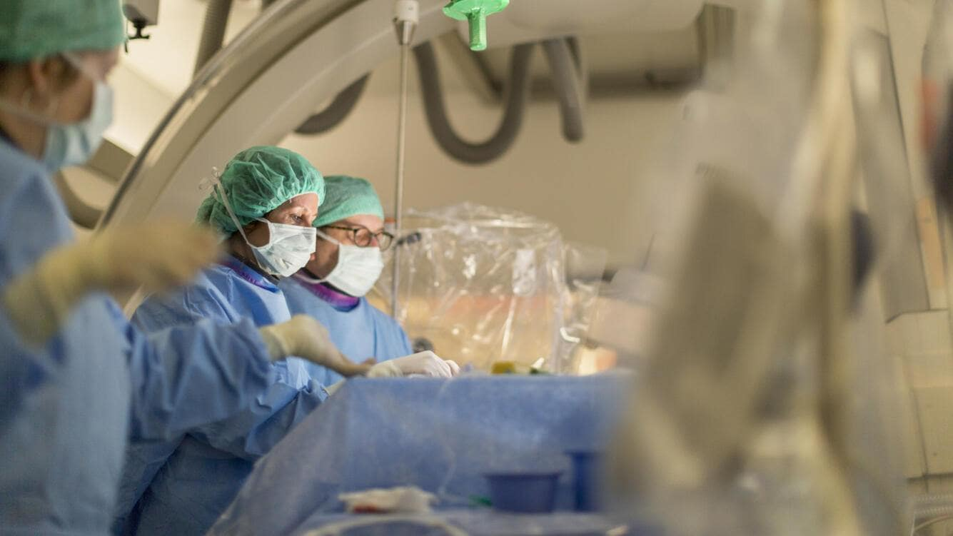 Prof. Dr. med. Isabel Wanke and Prof. Dr. med. Daniel Ruefenacht perform endovascular coiling to treat a brain aneurysm in the NeuroSuite operating theater at the Hirslanden Hospital in Zurich, Switzerland, on April 9, 2015.