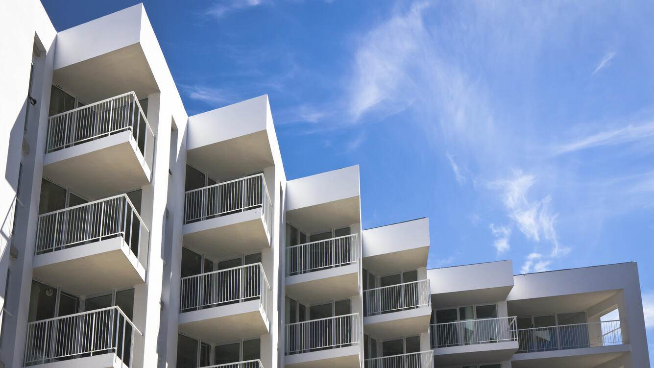 Rows of balconies in a new apartment house against blue skyclick for more...