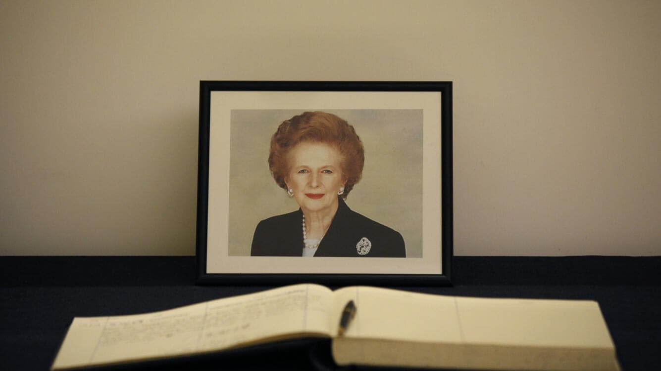 A condolence book is placed in front of a picture of former British Prime Minister Margaret Thatcher at the British Consulate in Hong Kong Tuesday, April. 9, 2013. Her spokesman said Thatcher died Monday morning of a stroke. (AP Photo/Vincent Yu)