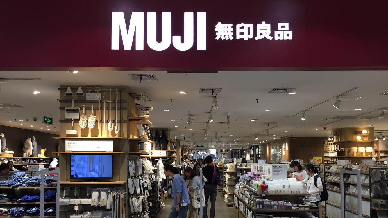 WUHAN, CHINA - MAY 05: Customers shop inside a MUJI store on May 5, 2018 in Wuhan, Hubei Province of China. MUJI Shanghai was fined 200,000 yuan ($31,300) for failing to properly fulfill the obligation to carry out the purchase inspection and selling mislabeled products which mark âTaiwan as the country of originâ on its products' packaging by the Shanghai Administration for Industry and Commerce.