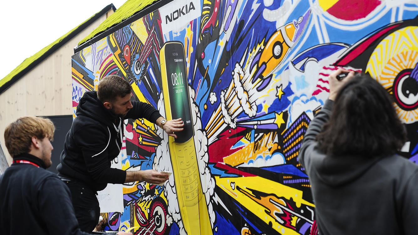 Members of Nokia staff, painting a wall with new Nokia 8110, during theMobile World Congress day 4, on March 1, 2018 in Barcelona, Spain.  (Photo by Joan Cros/NurPhoto via Getty Images)
