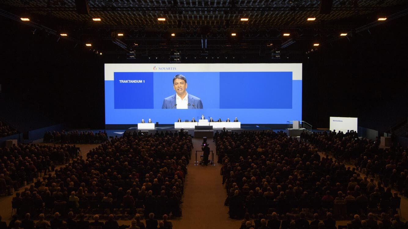 Vas Narasimhan, CEO Novartis, seen on the screen during the general assembly of Swiss Pharma group Novartis, at the St. Jakobshalle in Basel, Switzerland, this Friday, March 2, 2018. (KEYSTONE/Anthony Anex)