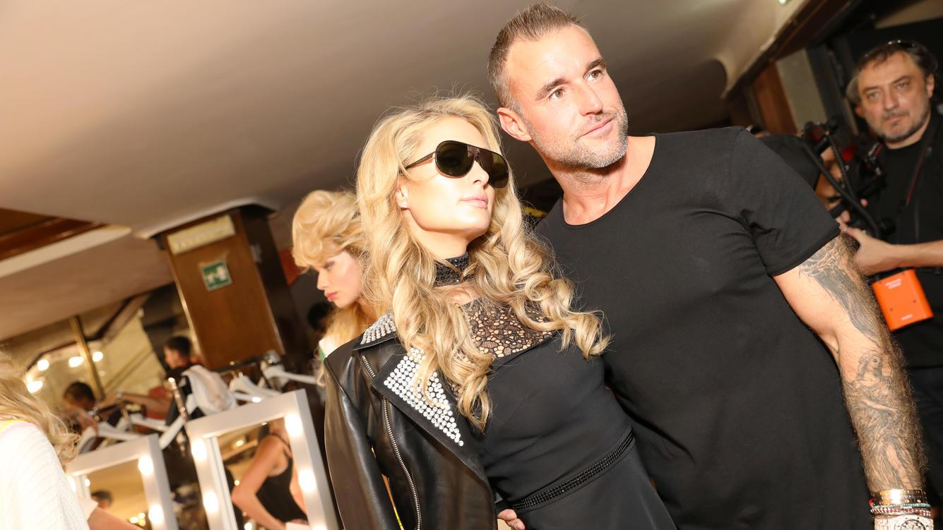 MILAN, ITALY - JUNE 16:  Paris Hilton and Philipp Plein are seen backstage ahead of the Plein Sport show during Milan Men's Fashion Week Spring/Summer 2019 on June 16, 2018 in Milan, Italy.  (Photo by Tristan Fewings/Getty Images)