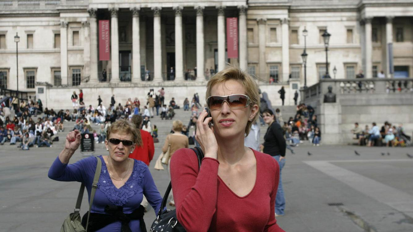 A tourist uses her mobile