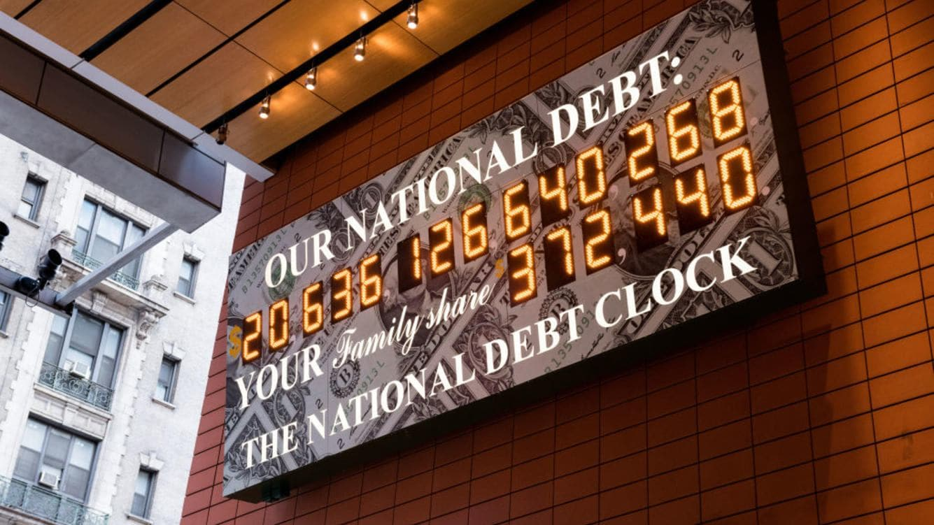 The National Debt Clock is a very very large digital display of the current gross national debt of the United States. It is mounted on a western facing wall in a wide covered alley in the middle of the block and runs between West 42nd Street and West 43rd Street. The alley is located between Sixth Avenue and Broadway in New York City. The displayed debt shown is as of March 23, 2018 when this image was created. (Photo by Michael Brochstein/SOPA Images/LightRocket via Getty Images)