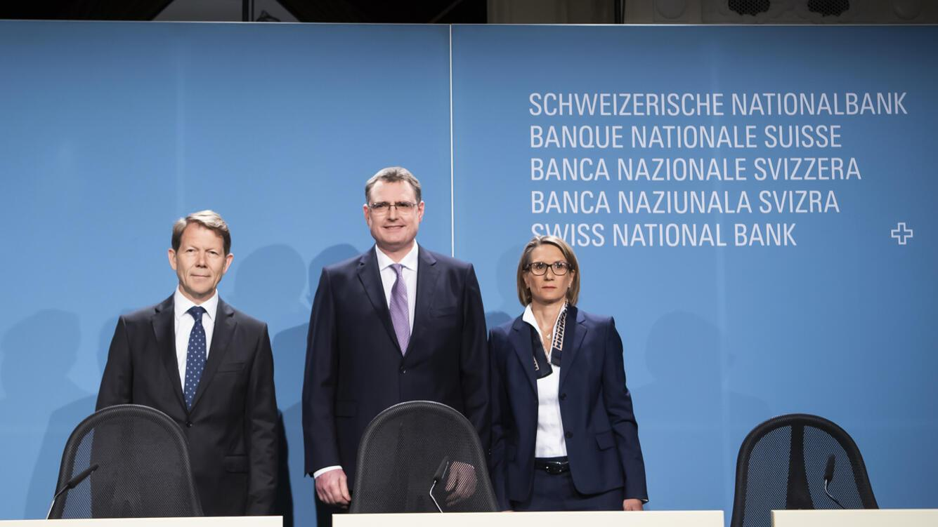 Swiss National Bank's (SNB) Vice Chairman of the Governing Board Fritz Zurbruegg, Swiss National Bank's (SNB) Chairman of the Governing Board Thomas Jordan, and Swiss National Bank's (SNB) Member of the Governing Board Andrea Maechler, take a pose during a semi-annual conference in Bern, Switzerland, Thursday, June 13, 2019. (KEYSTONE/Anthony Anex)